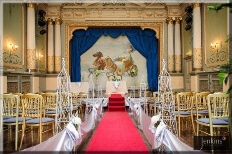 Craig y Nos Castle Wedding Ceremony Room red aisle carpet, white drapes down sides of aisle