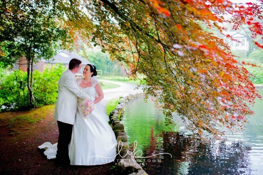 Bridal Couple in the County Park by the Lake -  Weddings Venue South Wales Craig y Nos Castle