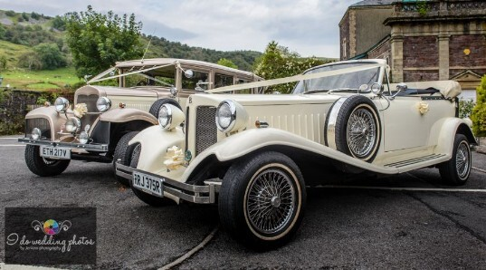 Vintage Cream Wedding Cars in the Courtyard at Craig y Nos Castle