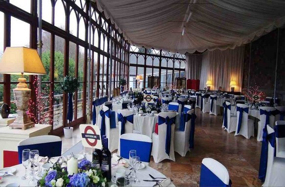 Blue ribbons Craig y Nos Castle Conservatory with London underground table names