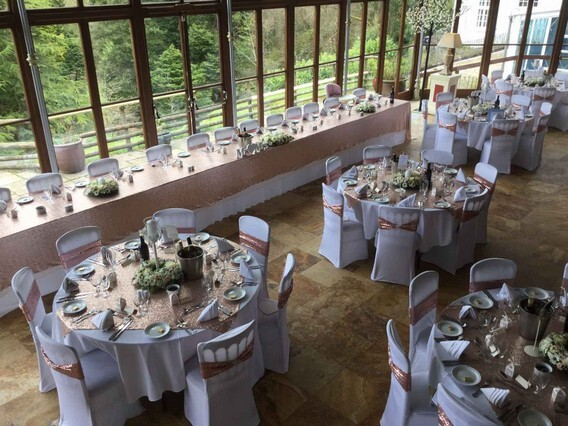 Conservatory wedding reception gold and white table decor