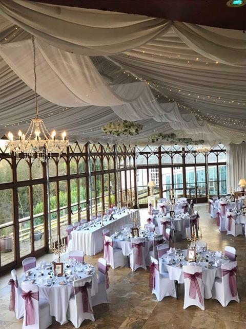 Craig y Nos Castle Wedding Venue Swansea Conservatory with tables set up ready for wedding