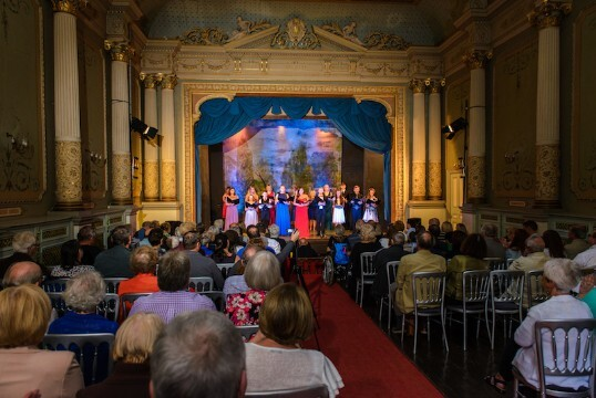 Shows the opera House in use for a Summer operatic Concert