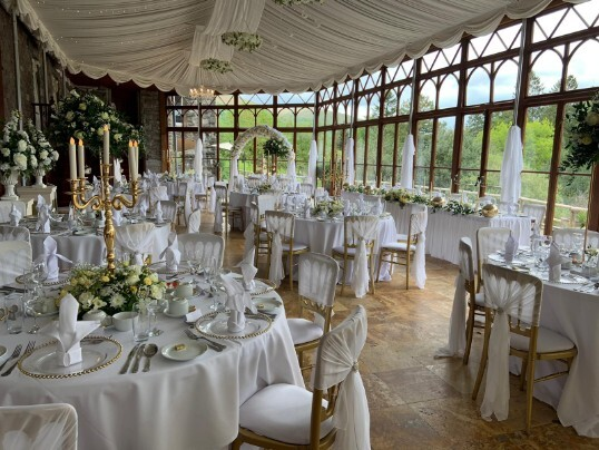 Craig y Nos Castle Wedding Venue Swansea Conservatory Wedding Breakfast pale yellow ribboned chair covers
