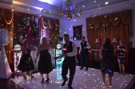 Pure Weddings DJ Evening Entertainment Package guests party on dance floor