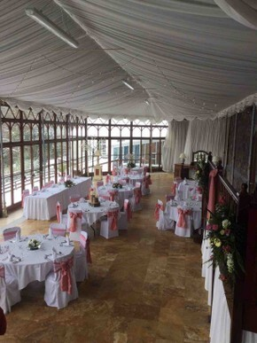 Open day Craig y Nos Castle Conservatory pink ribbons white chair covers