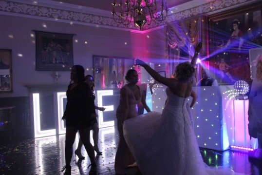 Pure Wedding taking party photography in the Function Room