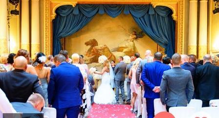 Guests stand for Bride & Groom in the Wedding Ceremony Room at Craig y Nos Castle