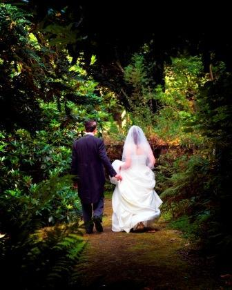 Bride and Groom walking in Craig y Nos Country Park