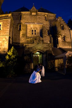 Bride and groom in front of Craig y Nos Castle Wedding Venue at night