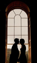 Chris Barroccu Wedding Photographer Bride and Groom in front of large window