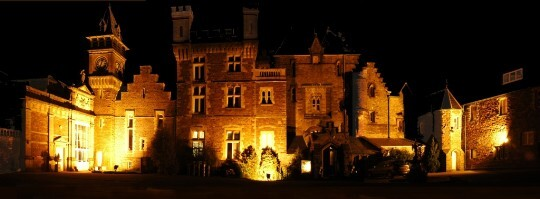 Craig y Nos Castle floodlit at night