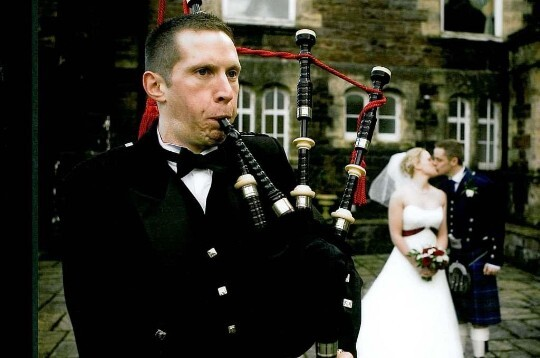 Wedding Planner Guide, Bagpiper on theatre terrace at Craig y Nos Castle and wedding couple