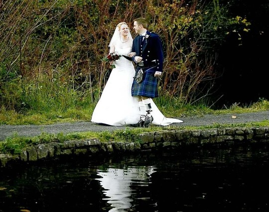 Wedding Planner Guide, Wedding Couple by Lake in Craig y Nos Country Park