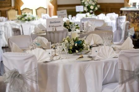 Craig y Nos Castle in South Wales Wedding Breakfast table setting white table cloths and white napkins