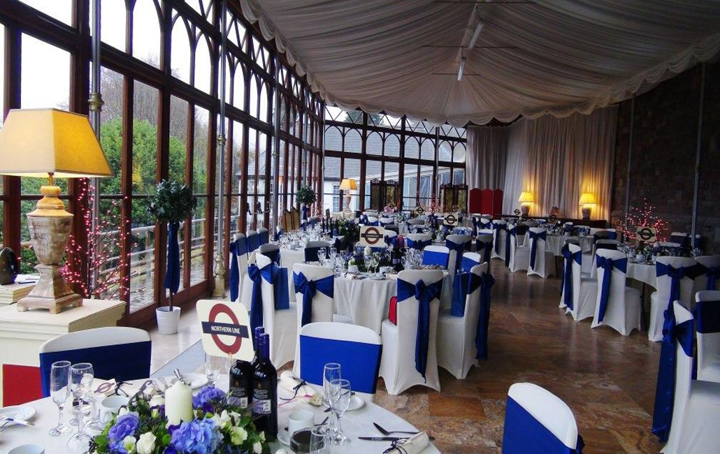 A London themed Wedding Breakfast in the Conservatory at Craig y Nos Castle