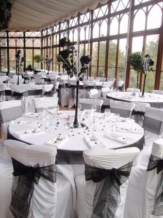 South Wales Wedding Venue Craig y Nos Castle Conservatory Black and White Chair covers and Tables