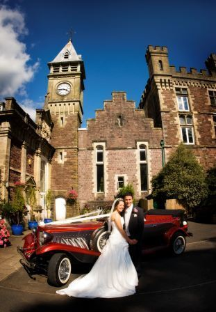 Bride and Groom by red Wedding Car craig y nos castle clocktower