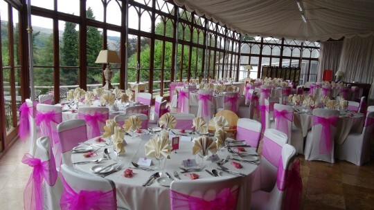 Craig y Nos Castle Wedding Venue Swansea Conservatory with light purple chair covers