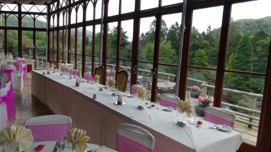Craig y Nos Castle Wedding Venue Swansea Conservatory Wedding Breakfast head table with pink colours