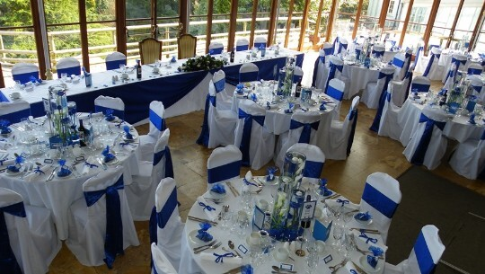 Craig y Nos Castle Wedding Venue with deep Blue ribbons on crisp white chair covers