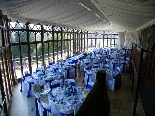 Craig y Nos Castle Wedding Venue Swansea Wedding Breakfast Room with Blue and White Chair Covers