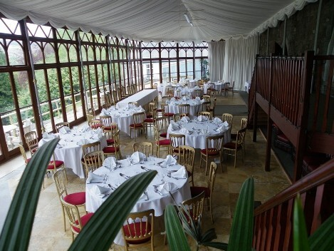 Craig y Nos Castle Wedding Venue in Swansea showing Conservatory Wedding Breakfast with white linen