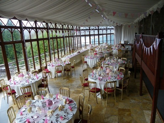 Craig y Nos Castle Wedding Venue Swansea Conservatory Wedding Breakfast pink flowers theme and bunting