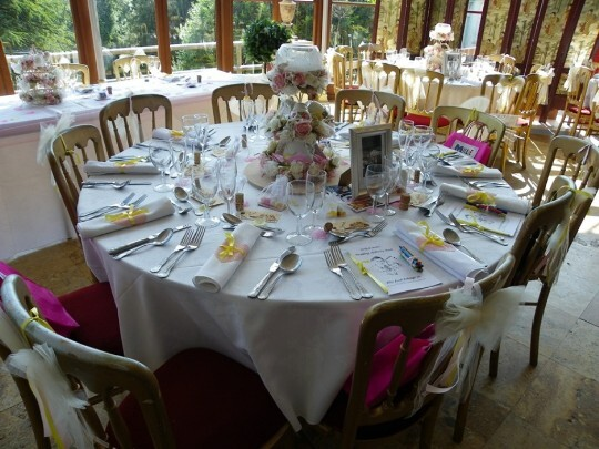 Craig y Nos Castle Wedding Venue in Swansea Valley table setting with rolled table cloths tied wiith yellow ribbon