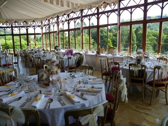 Craig y Nos Castle Wedding Venue Conservatory with tables set up for a Wedding Breakfast