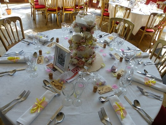 Craig y Nos Castle Wedding Venue table setting with white linen napkins rolled with yellow ribbon