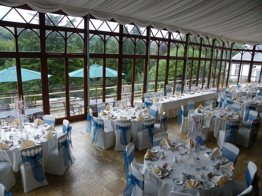 Craig y Nos Castle Wedding Venue Swansea Conservatary laid up in blue and white colours for wedding