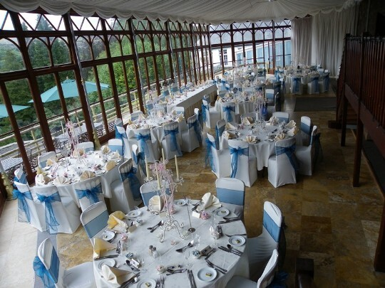 Craig y Nos Castle Wedding Venue Swansea Conservatory laid up in blue and white for a Wedding Breakfast
