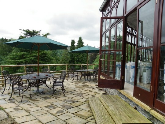 Craig y Nos Castle Wedding Venue in South Wales showing the Conservatory terrace and garden tables