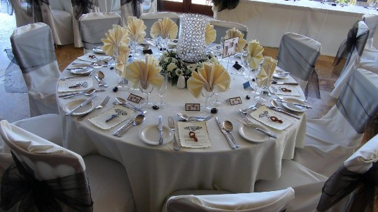 A table laid up for a wedding breakfast at Craig y Nos Castle's Conservatory mainly in white