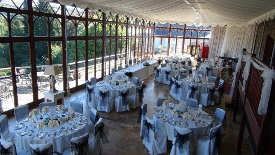 Craig y Nos Castle Wedding Venue in South Wales with the Conservatory set up for wedding breakfast