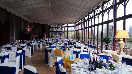 Craig y Nos Castle Wedding Venue the Conservatory set up for a wedding breakfast, blue and white theme