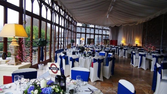 Craig y Nos Castle Wedding Venue with the Conservatory set up for a wedding breakfast blue and white