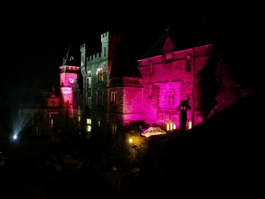 Craig y Nos Castle Wedding Venue Swansea Floodlit at Night in purples and greys