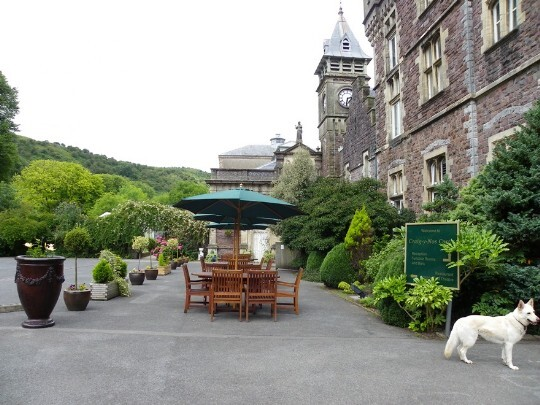 Craig y Nos Castle Wedding Venue in South Wales Front Courtyard showing clock tower and garden tables and chairs