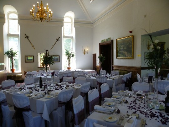 Craig y Nos Castle Wedding Venue in South Wales showing function room laid up for a wedding breakfast