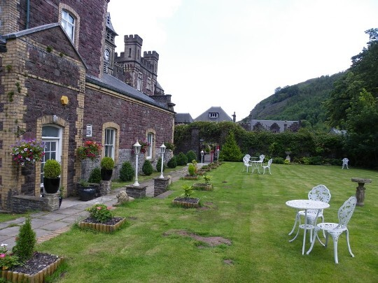 Craig y Nos Castle Wedding Venue Swansea Theatre Gardens with one side of theatre showing on left