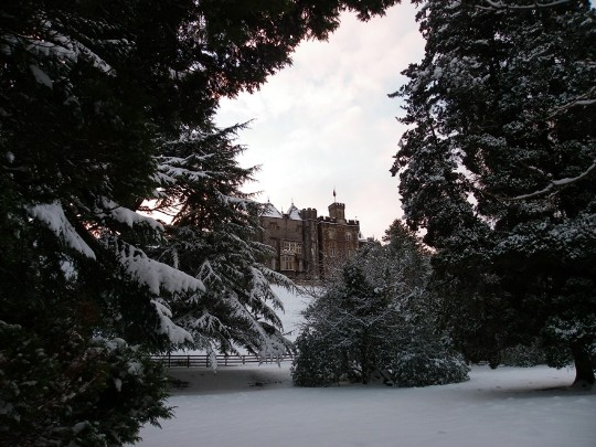 Craig y Nos Castle overlooking snow covered lower gardens and snow covered trees