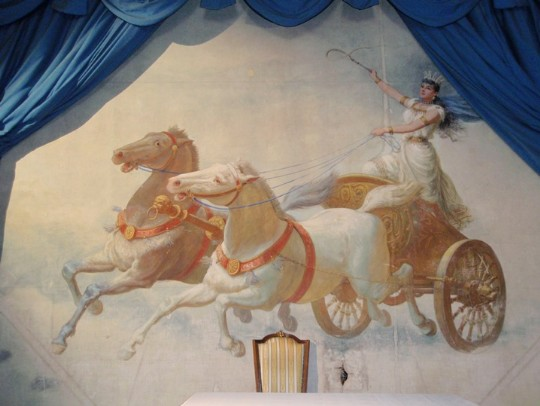 The theatre curtain at Craig y Nos Castle's theatre in South Wales featuring Adelina Patti riding a chariot