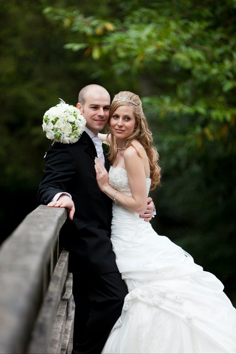 Craig y Nos Castle Wedding Venue in South wales couple on bridge over river Tawe in Country Park