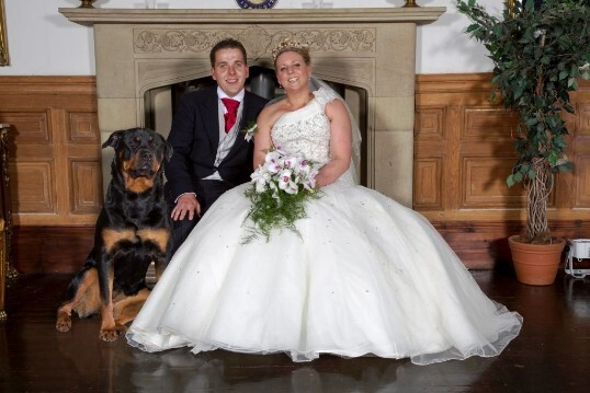 Bride and Groom with their dog Roxy in front of the fire place in music room at Craig y Nos Castle