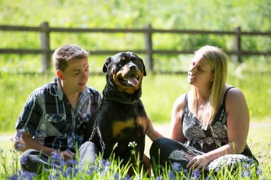 Craig y Nos Castle Wedding Venue lower gardens, wedding couple relax with their dog before wedding day