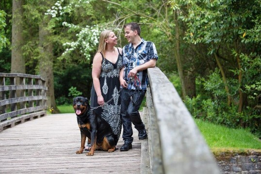 Dog Friendly Wedding Venue Craig y Nos Castle, couple with dog on bridge in Country Park