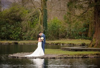 Wedding Couple by Craig y Nos Country Park Lake by Gareth Jones Wedding Photographer