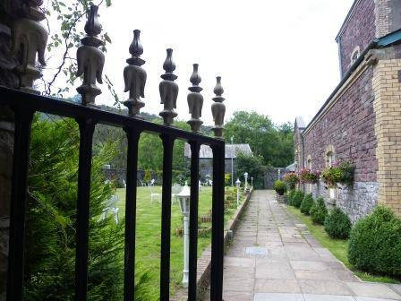 Wedding Venues South Wales - Craig y Nos Castle wrought iron gate into Theatre Gardens